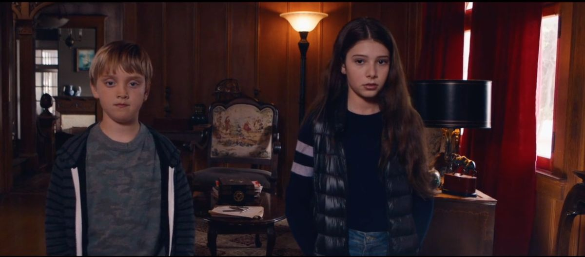 (L-R) O'Neill Monahan as Christopher and Makenzie Moss as Emily in the Sci-Fi / Thriller film, LET US IN, a Samuel Goldwyn Films release. Photo courtesy of Samuel Goldwyn Films.