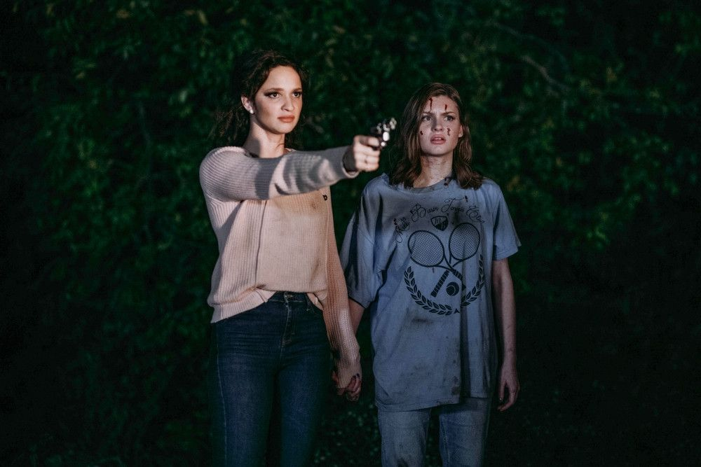 (L-R) Ruby Modine as Judi Ross and Hayley Griffith as Samantha Craft in the horror film SATANIC PANIC, an RLJE Films release. Photo courtesy of Eliana Pires.
