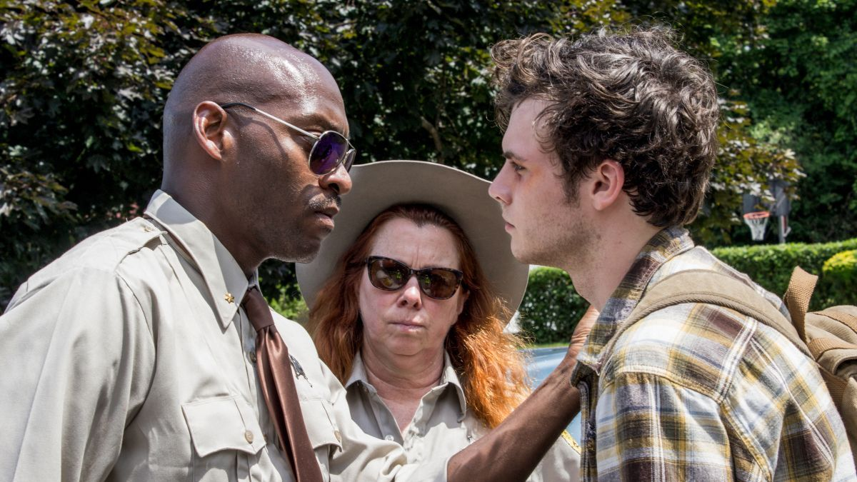 (L-R) Mu-Shaka Benson as Deputy Haiser, Siobhan Fallon Hogan as Sheriff Dorney, and Jay Jay Warren as Stan in the horror, thriller THE SHED, an RLJE Films release. Photo courtesy of RLJE Films.