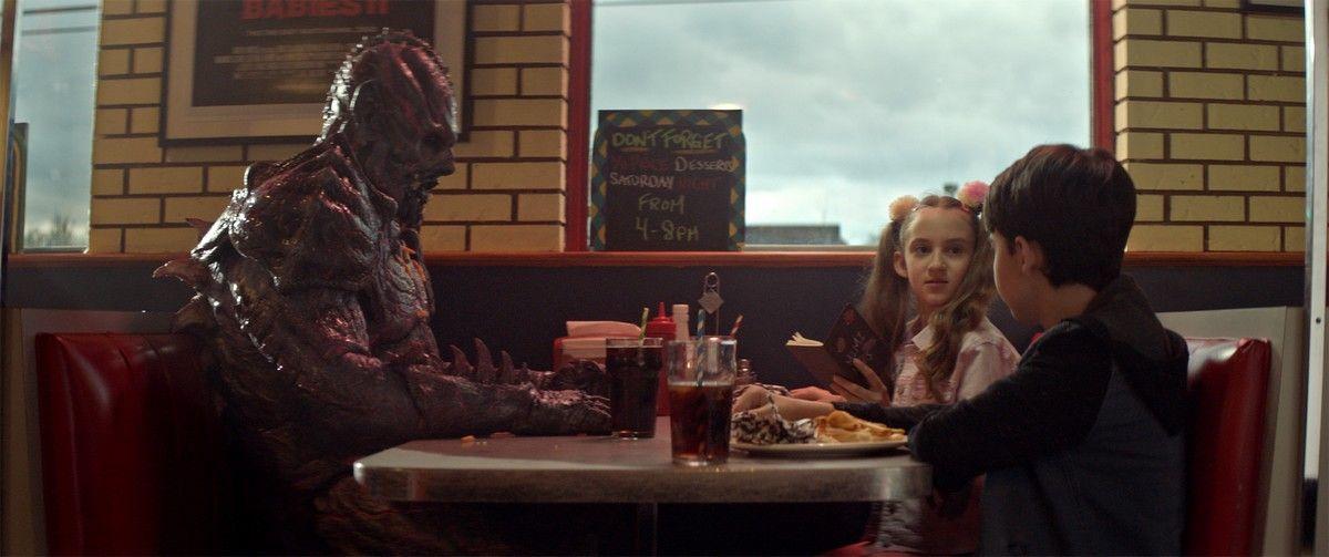 "(L-R) Matthew Ninaber as Psycho Goreman, Nita-Josee Hanna as Mimi and Owen Myre as Luke in the horror/action/comedy film, ""PG: PSYCHO GOREMAN,"" a RLJE Films/Shudder release. Photo courtesy of RLJE Films."