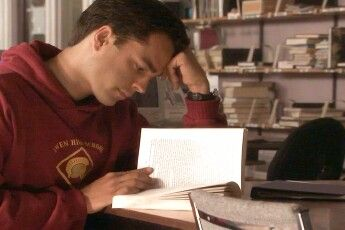 Tommy may be dreamy, but that book is upside down.